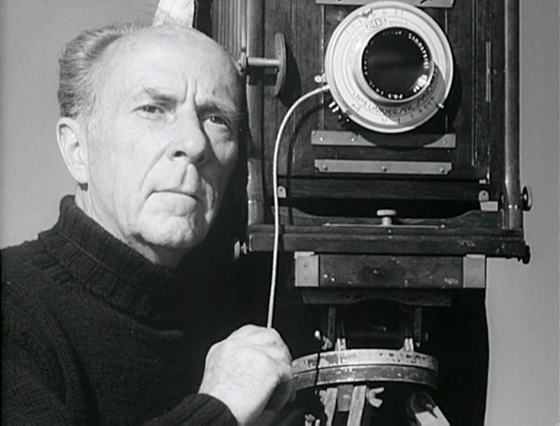 Edward Weston taking a photograph with a 14 Inch f/6.3 Kodak Commercial Ektar Lens in 'The Photographer,' Willard Van Dyke's 1948 documentary film.