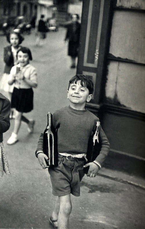 Henri Cartier-Bresson, Boy with wine bottles, France