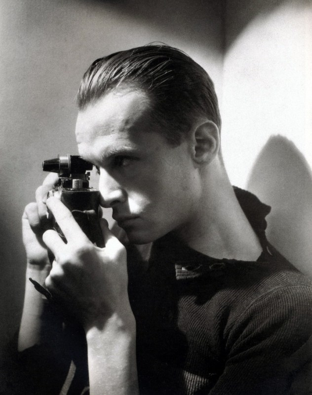 A young Henri Cartier-Bresson with his Leica 35mm rangefinder camera